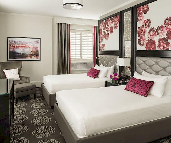 Two double beds room with peony decor.