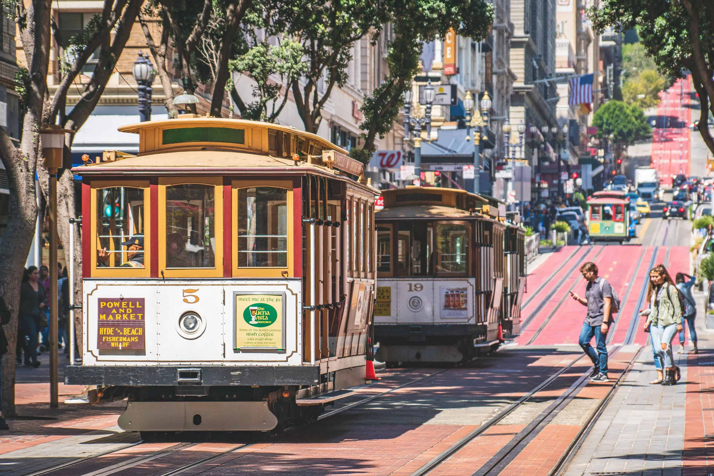 Powell and Market trolley climbing hill in San Francisco.